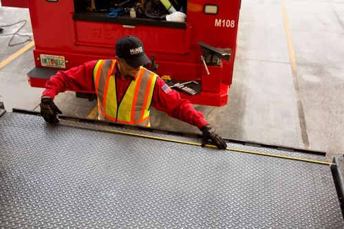Loading dock plate installation and maintenance